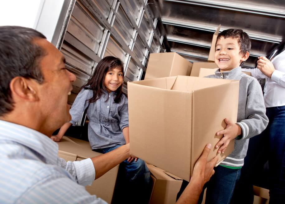 Family helping load storage unit in new york